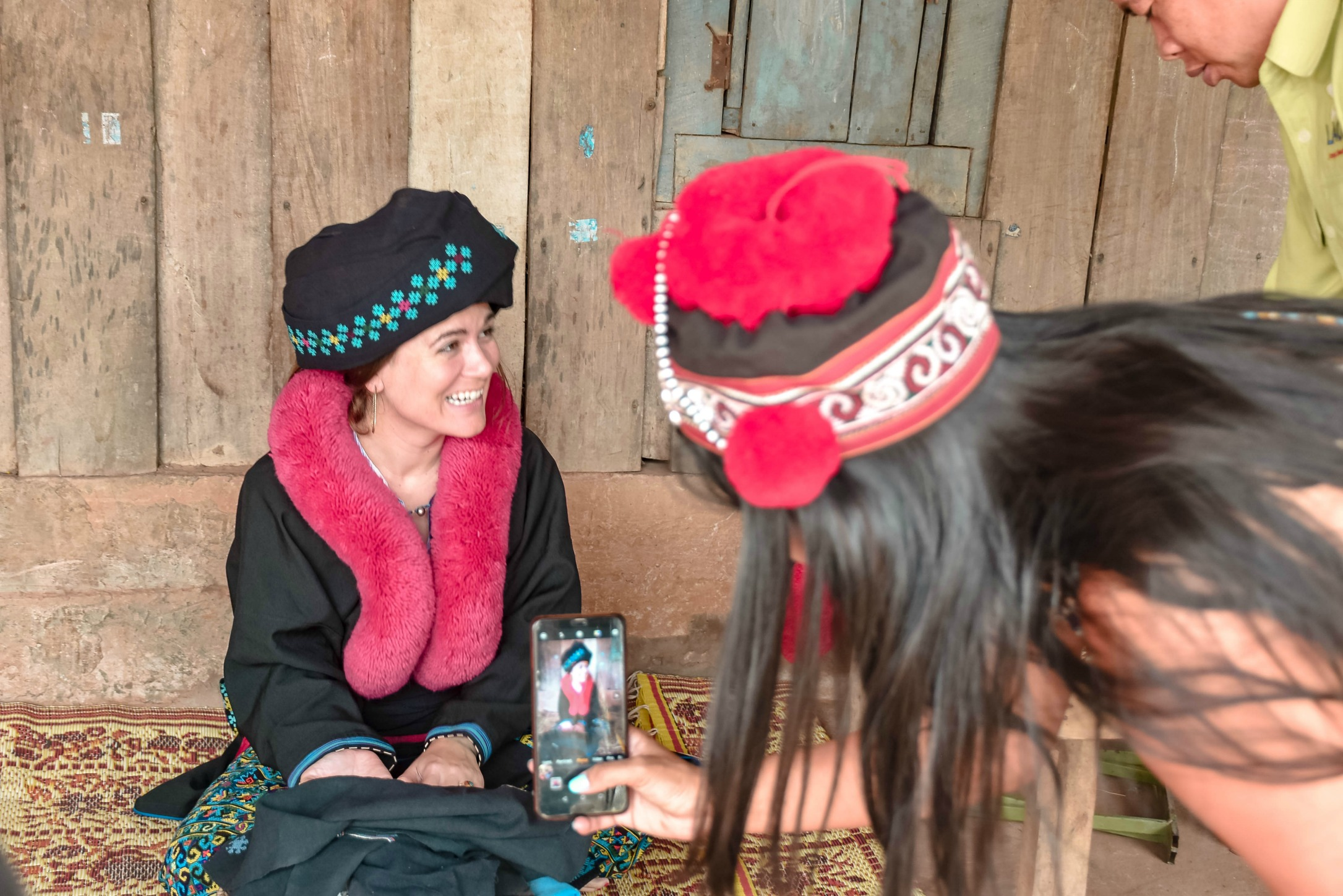 WEARING THE CULTURAL COSTUME OF THE YAO PEOPLE