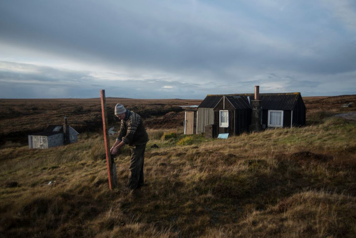Jon Macleod recovers a camera from the Ness moor (photo Alex Boyd).