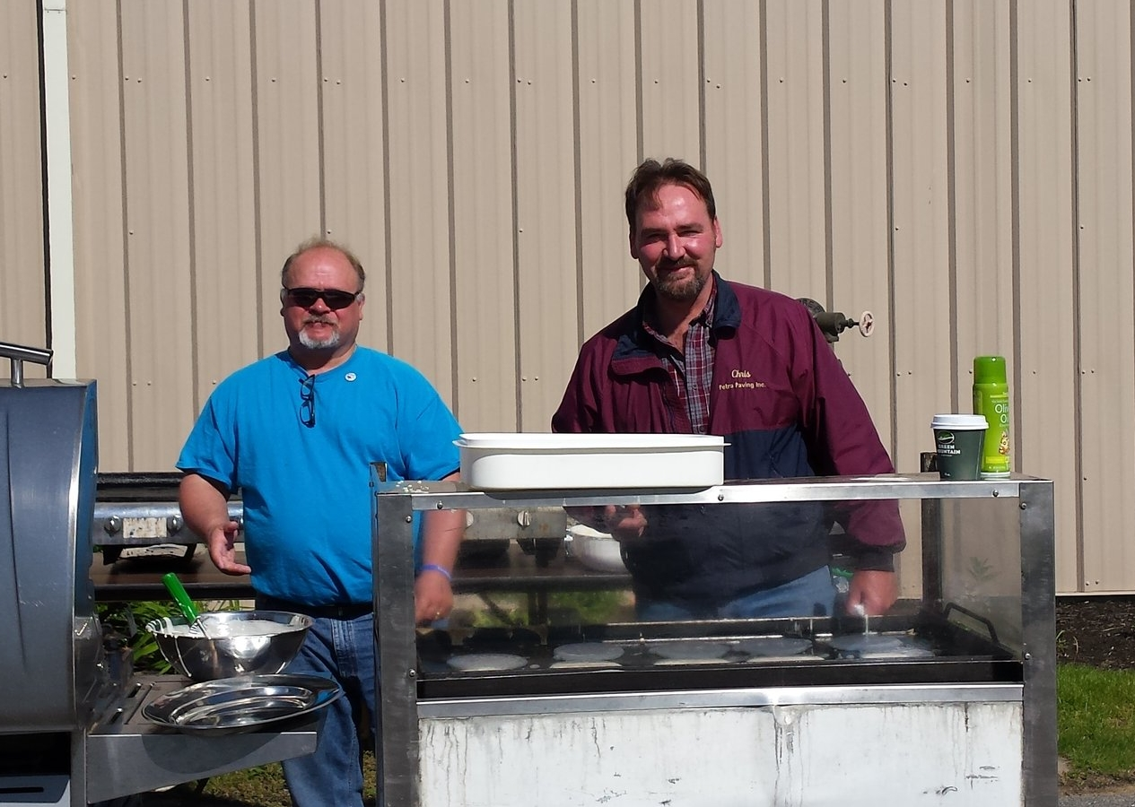 Brian and Chris cooking at last year's Blessing of the Bikes