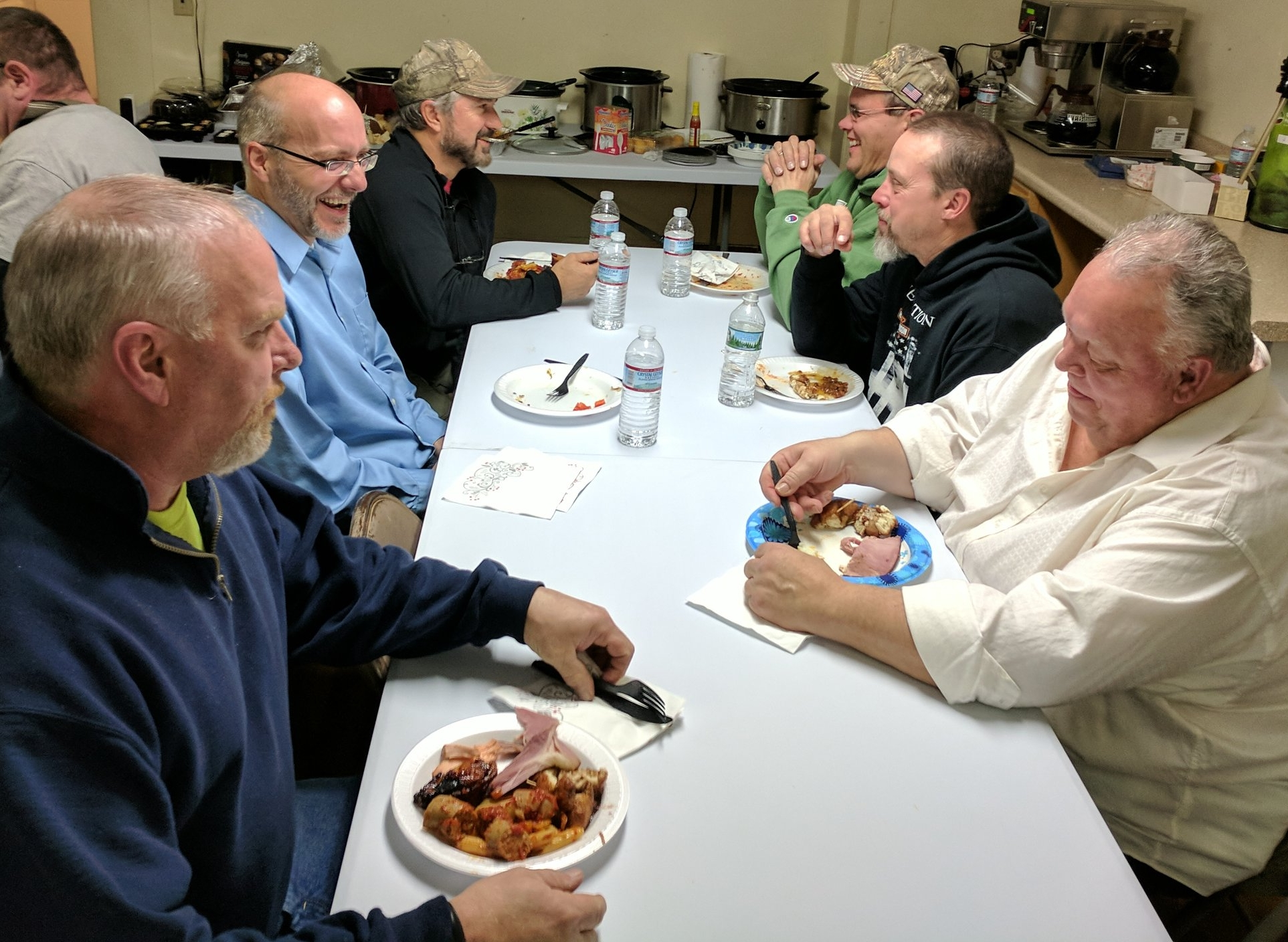 """A few of the guys enjoying time together at the """"Men's Christmas Feast!"""""""