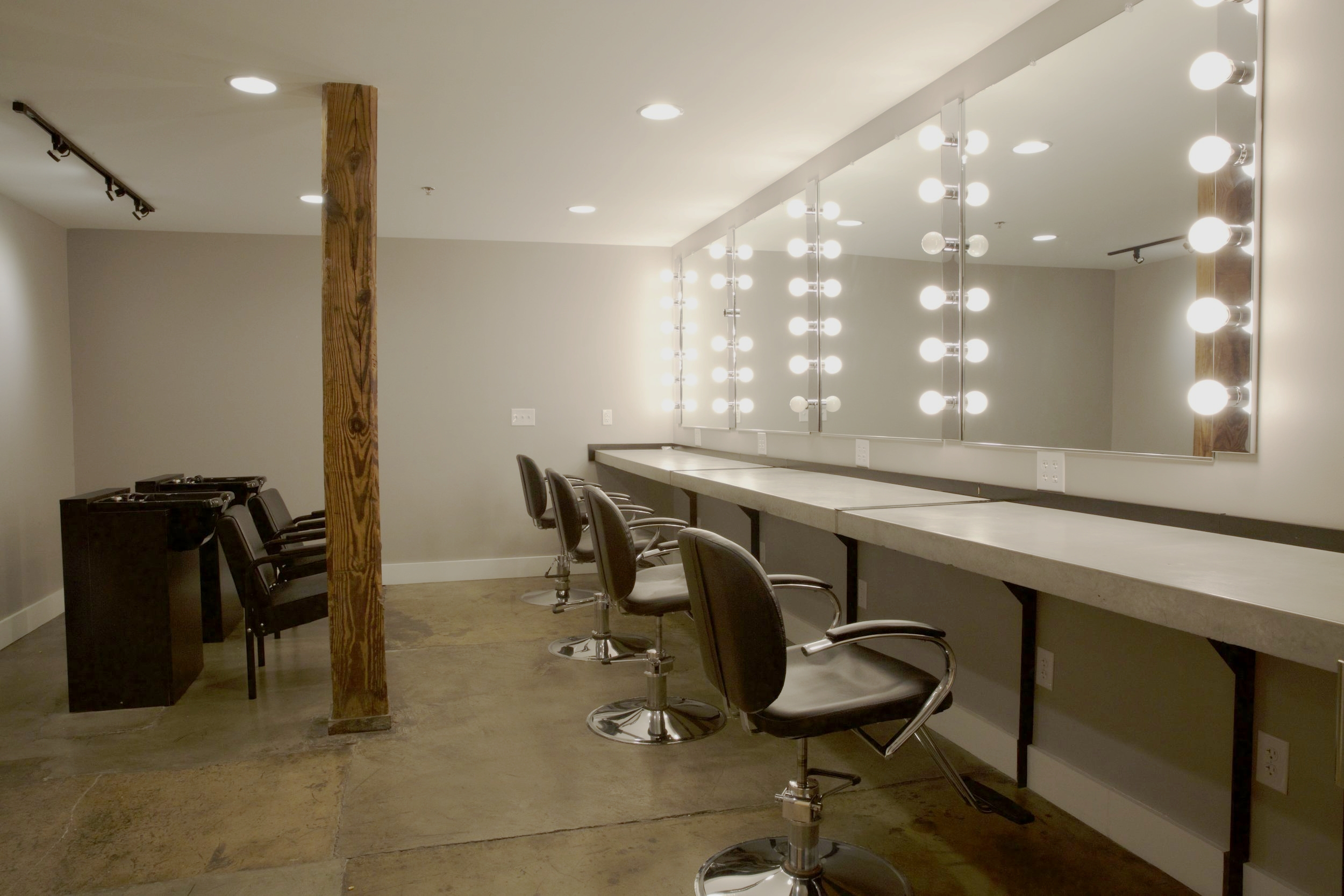 Complete hair and make-up room with sinks for actors.