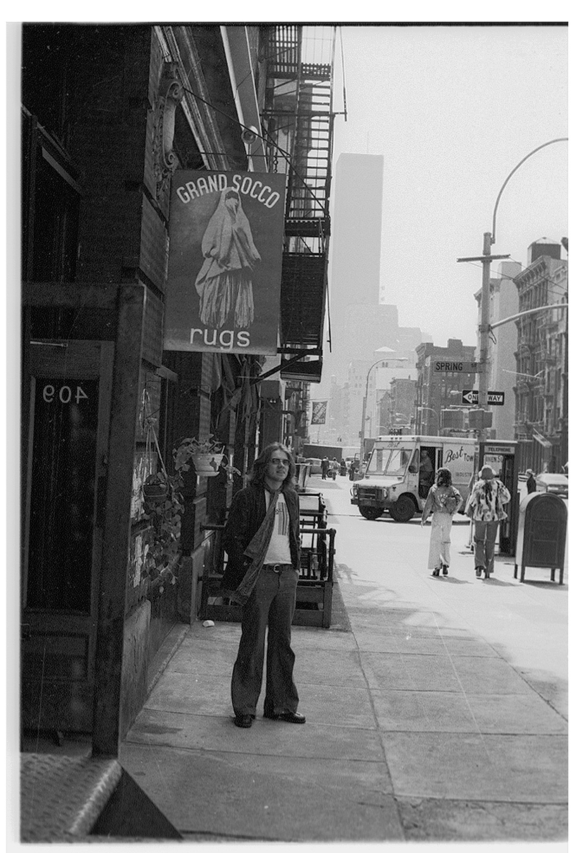 The author / photographer in 1973 on Thompson and Spring Streets in SoHo. One of the World Trade Towers in background,
