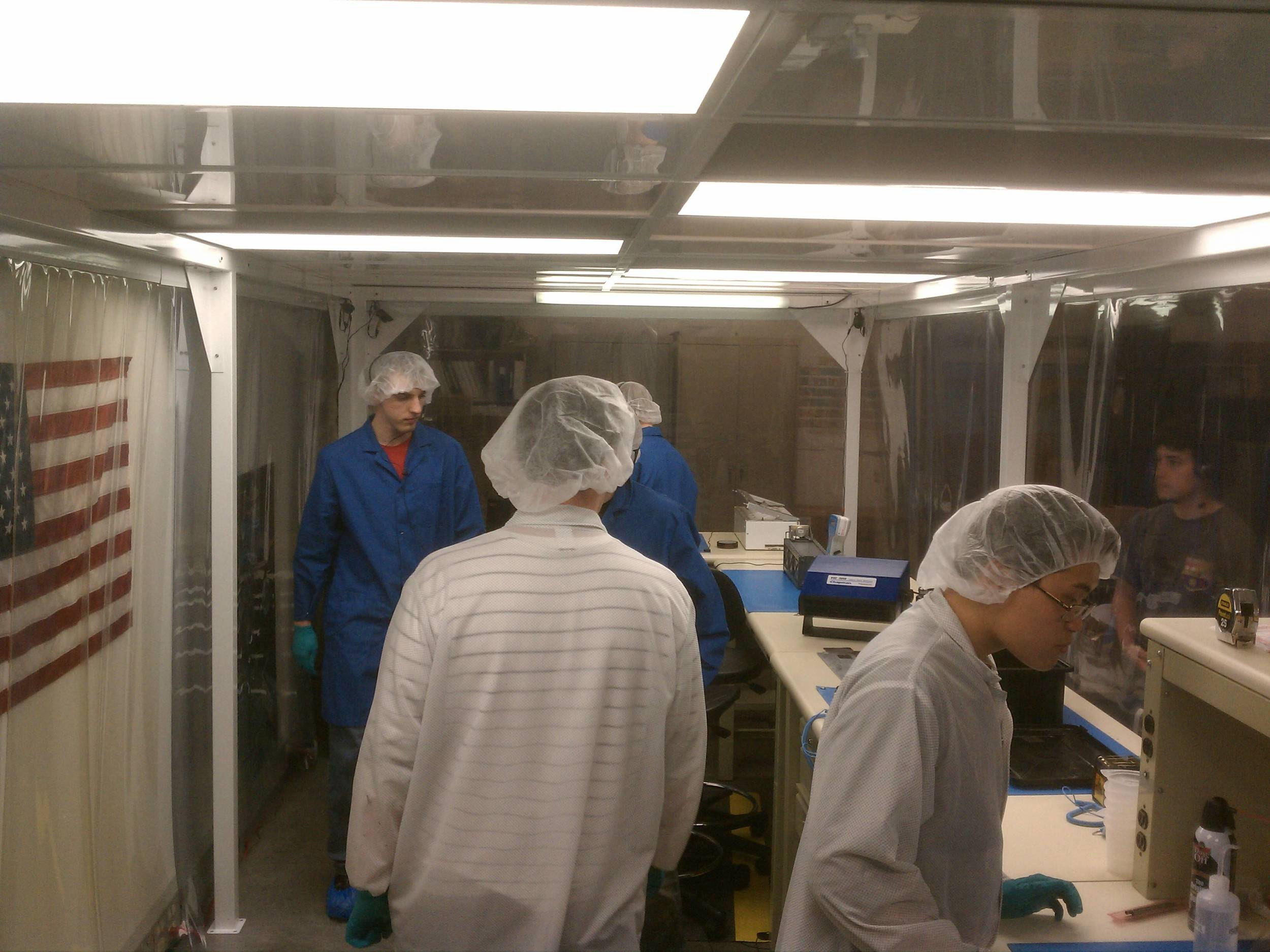 PolySat students busy in the clean room, learning how to install solar cells