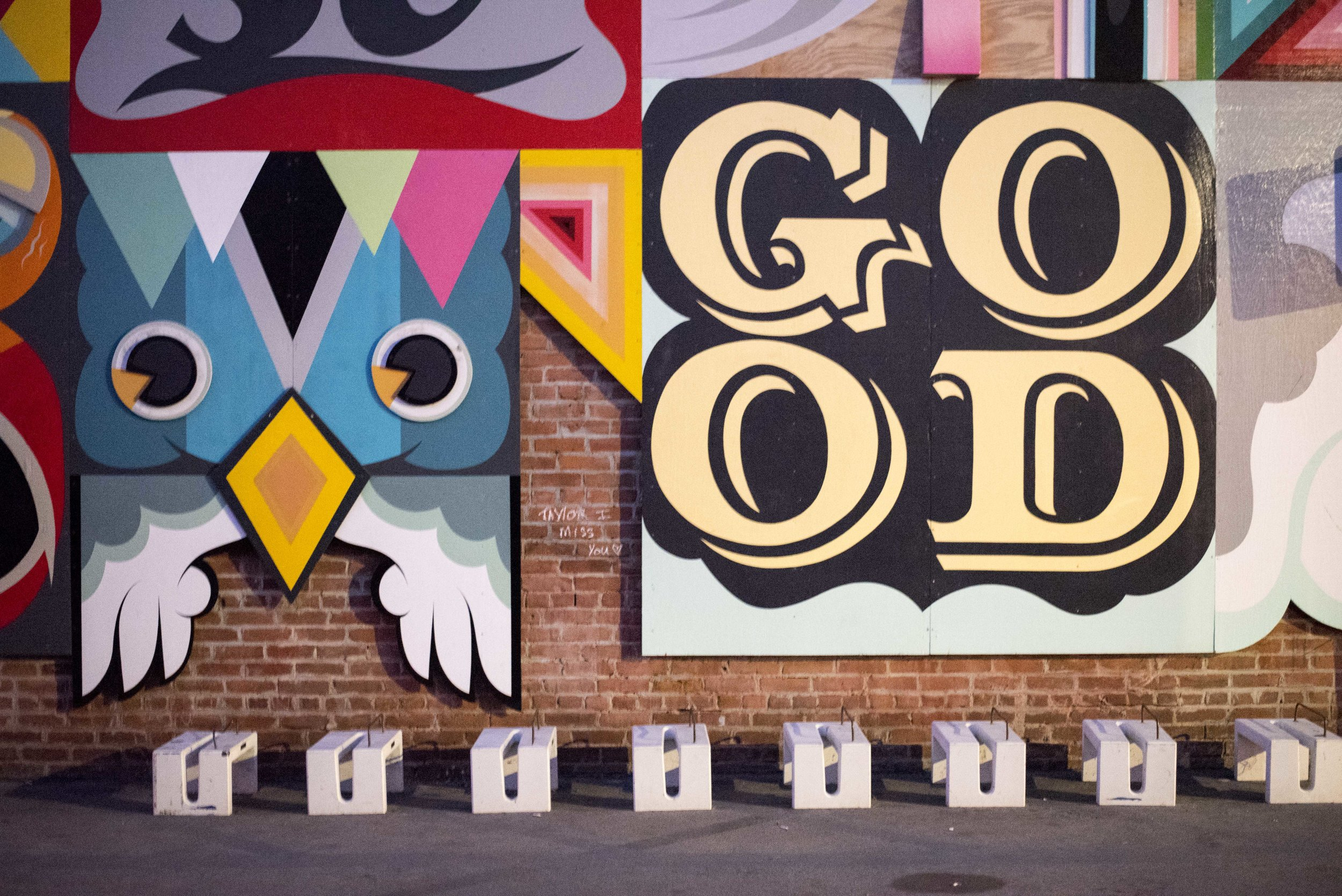 Bright and bold illustrations cover the street alleys.