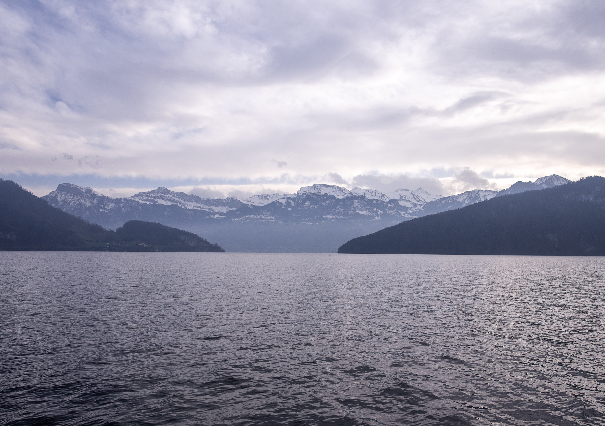 Snow-capped mountains surrounding the lake.