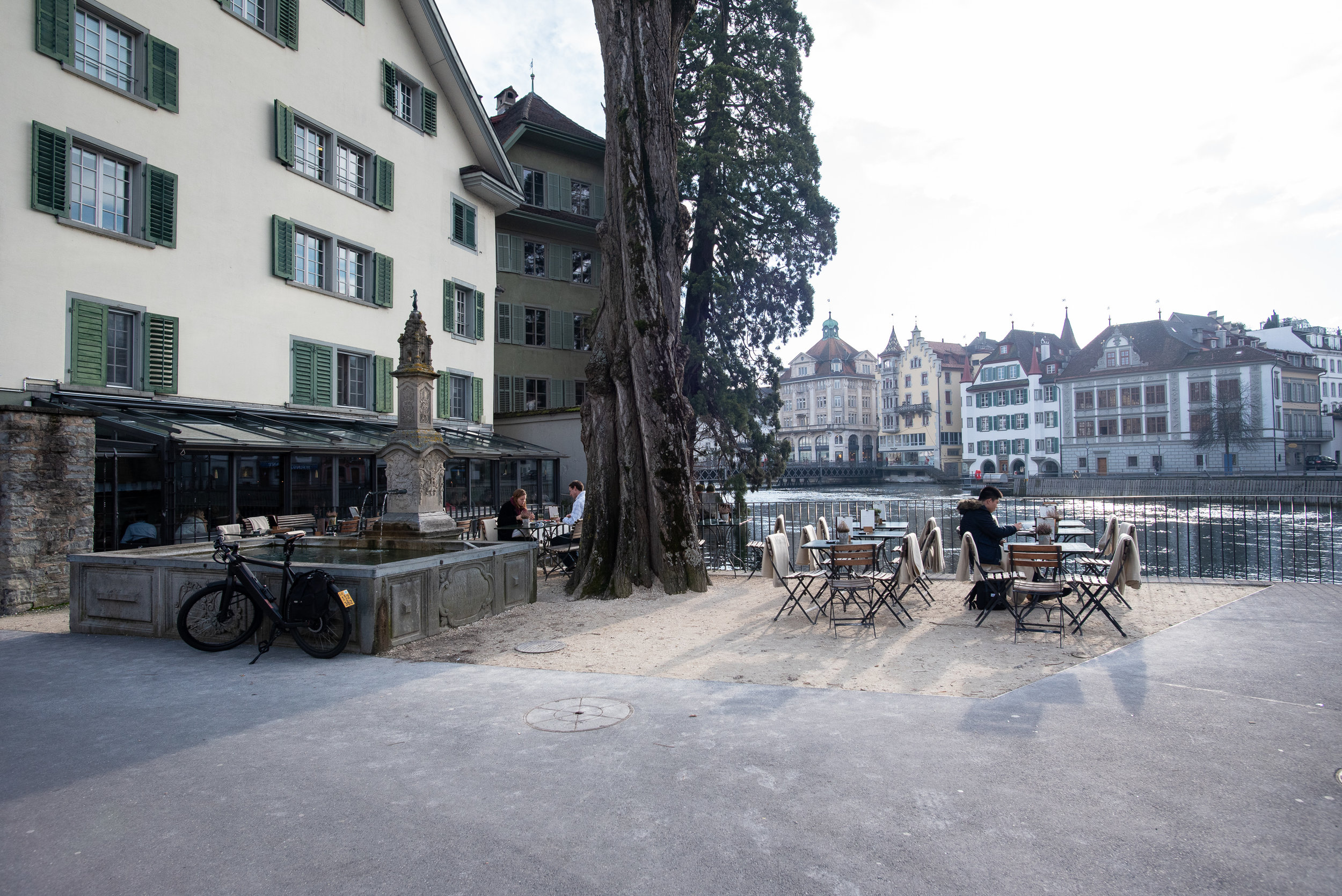 Cafe with patio seating by the water, just steps from The Tourist City & River Hotel.
