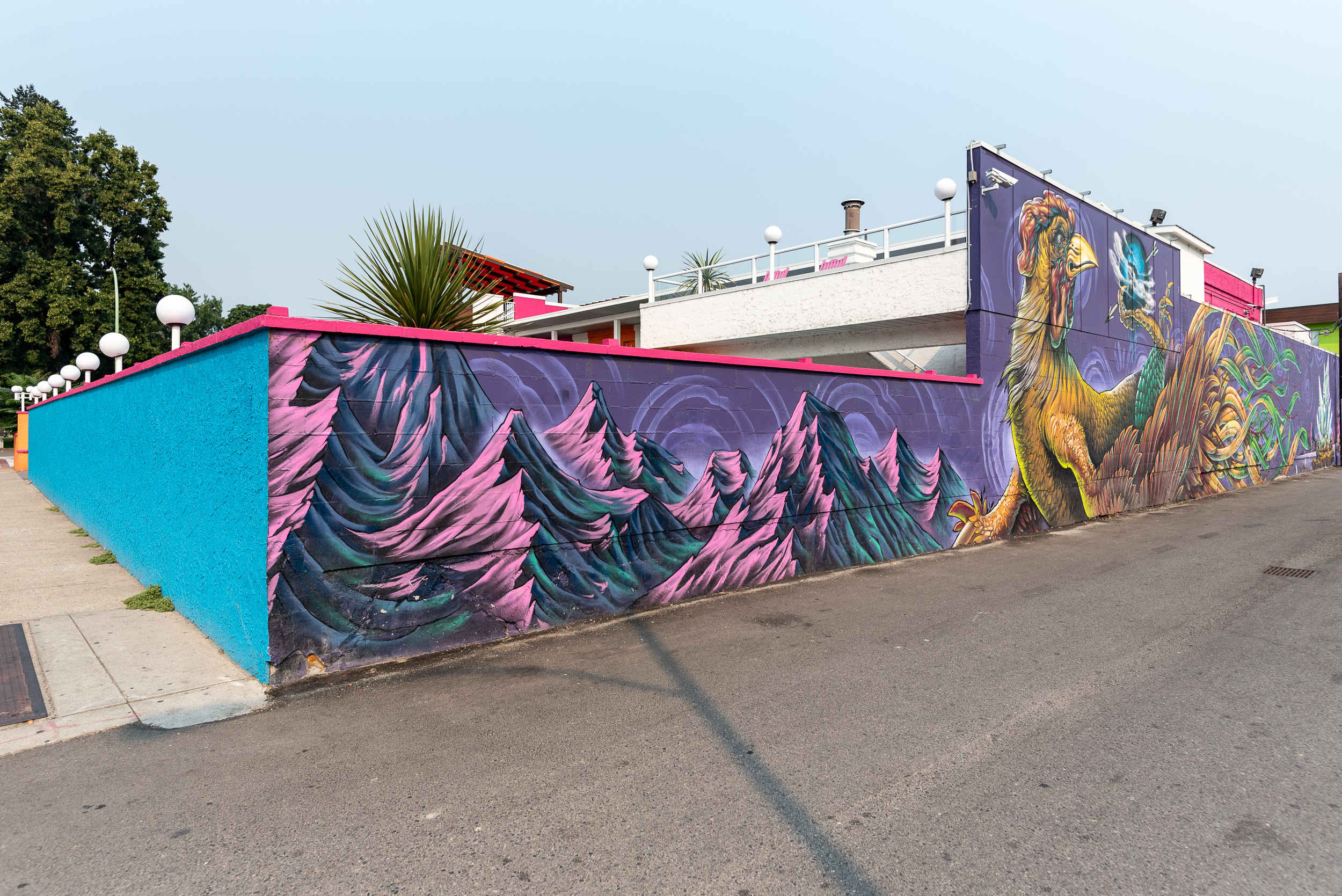 Large-scale mural on the side of the property.