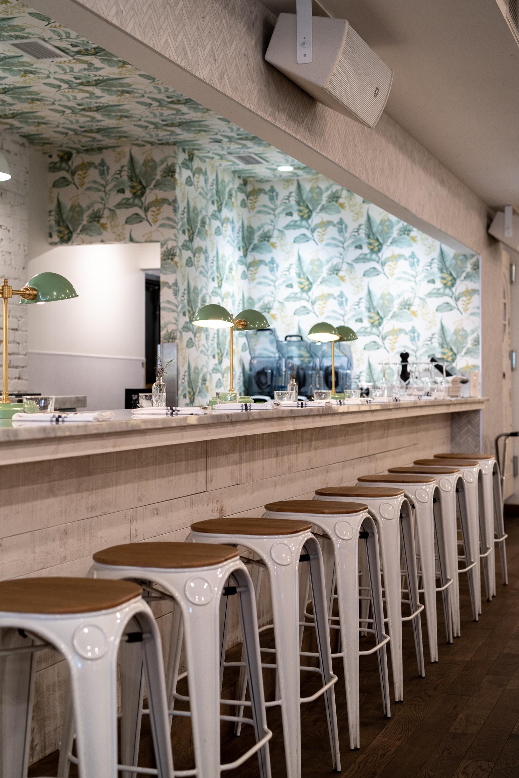 Beautiful wallpaper in the back bar area.