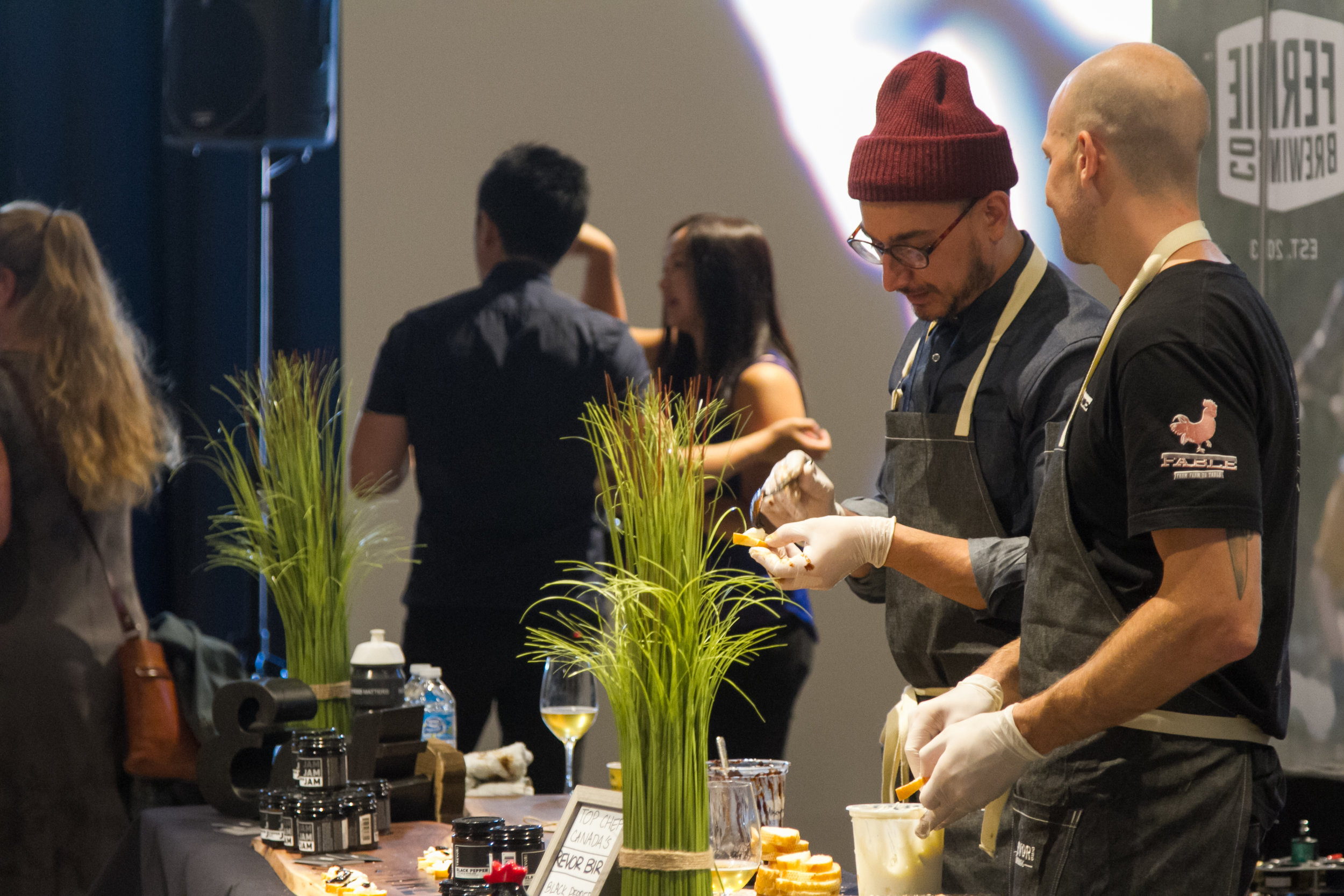 Trevor Bird preparing the black jam crostini himself at the Cheese and Meat Festival Vancouver.