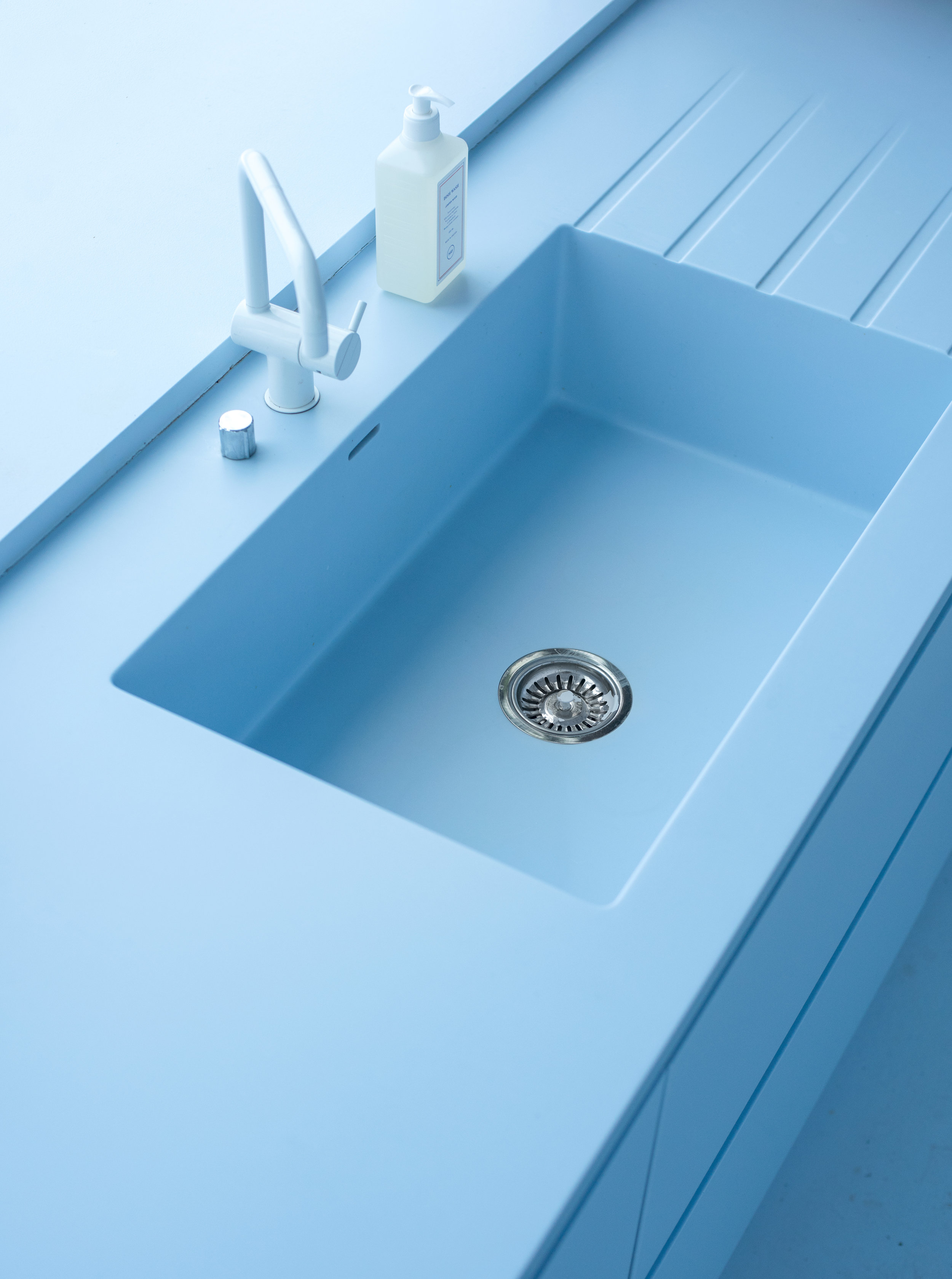 Even the bottom of the sink is a calming Azure Blue.