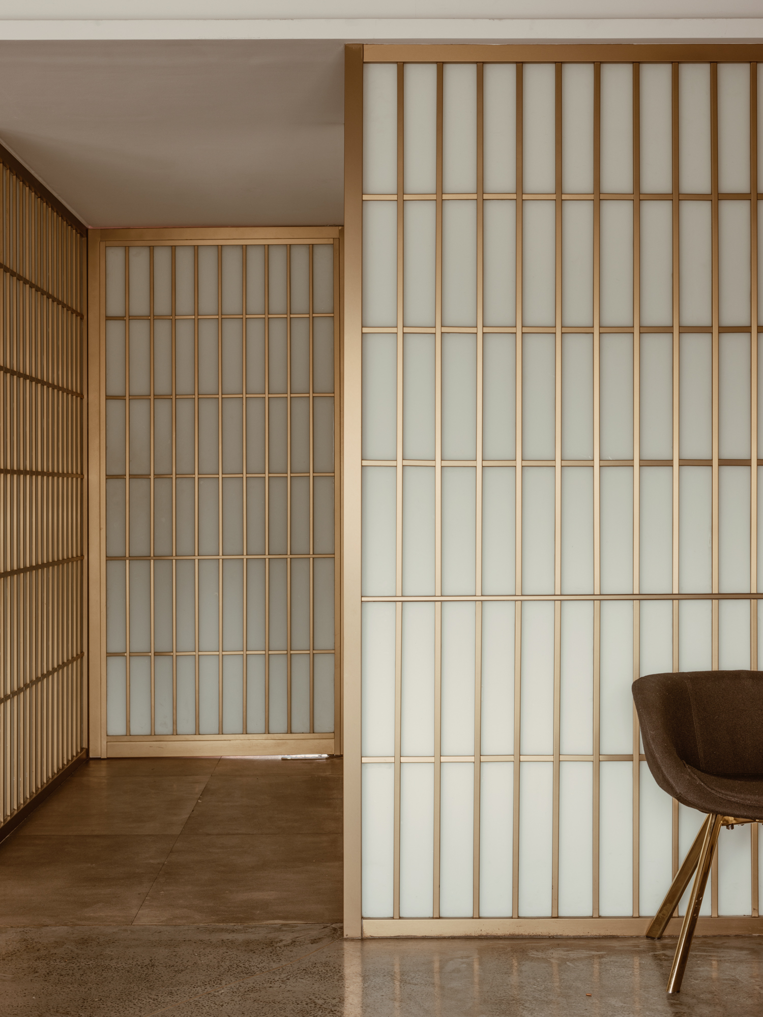 Brass Metal Screen with semi-translucent glass panels for movable and sliding partitions.