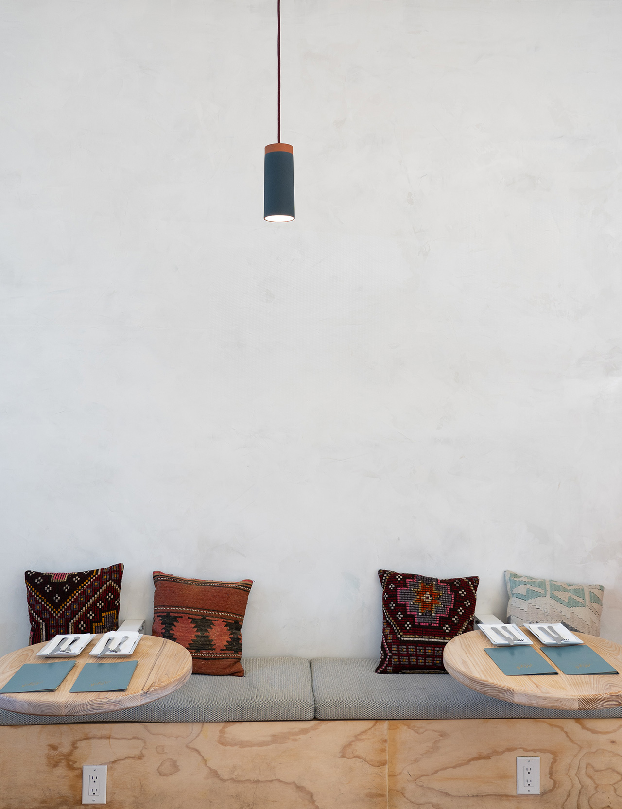 Cozy, side-by-side seating along the wall.
