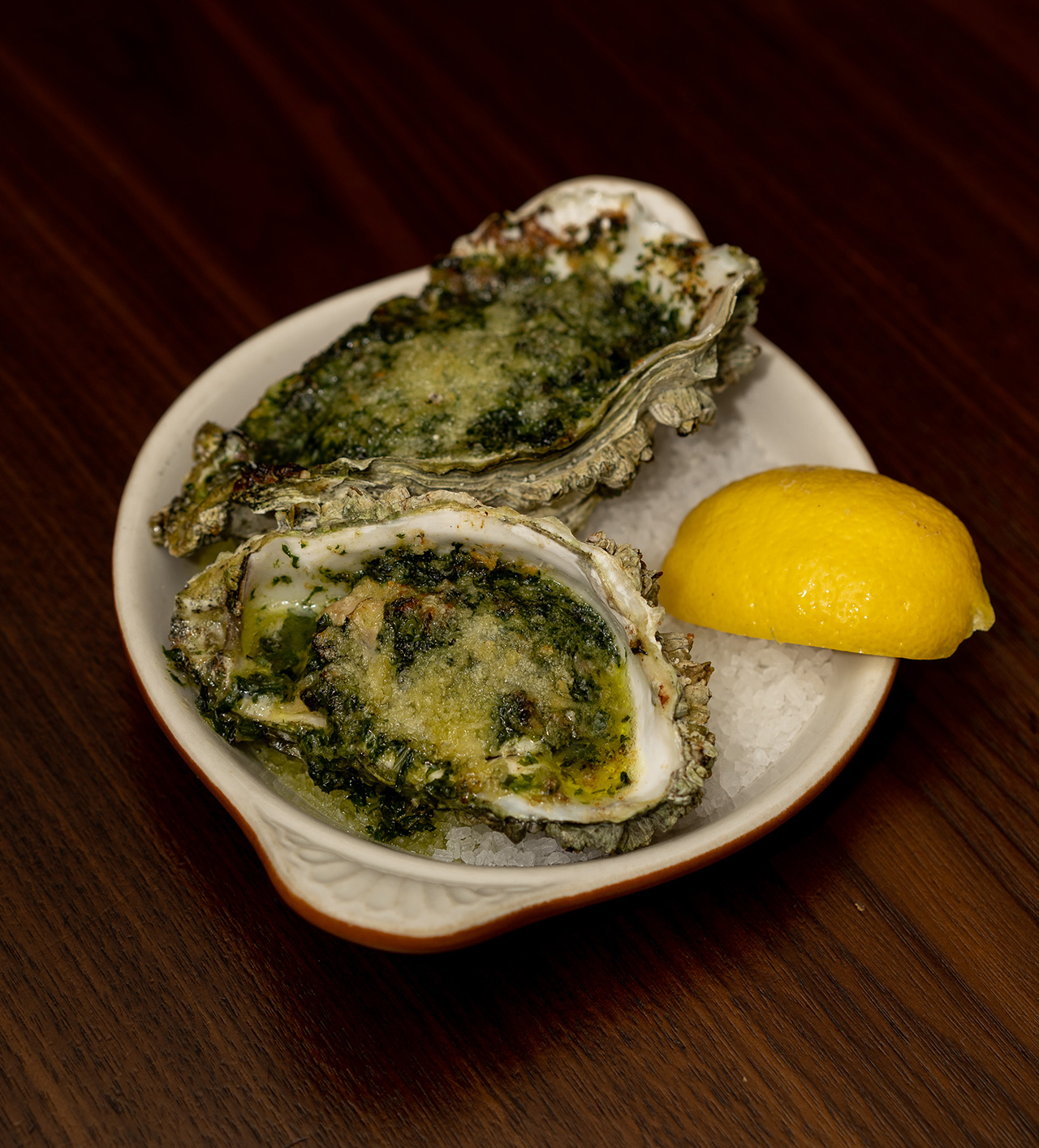 Oysters baked in a butter garlic sauce.