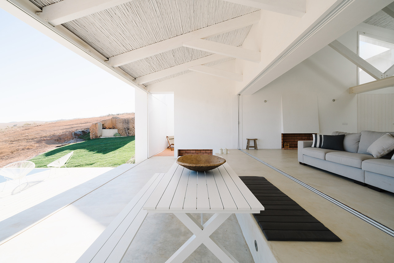 The home with the sliding panels open to reveal the horizon.