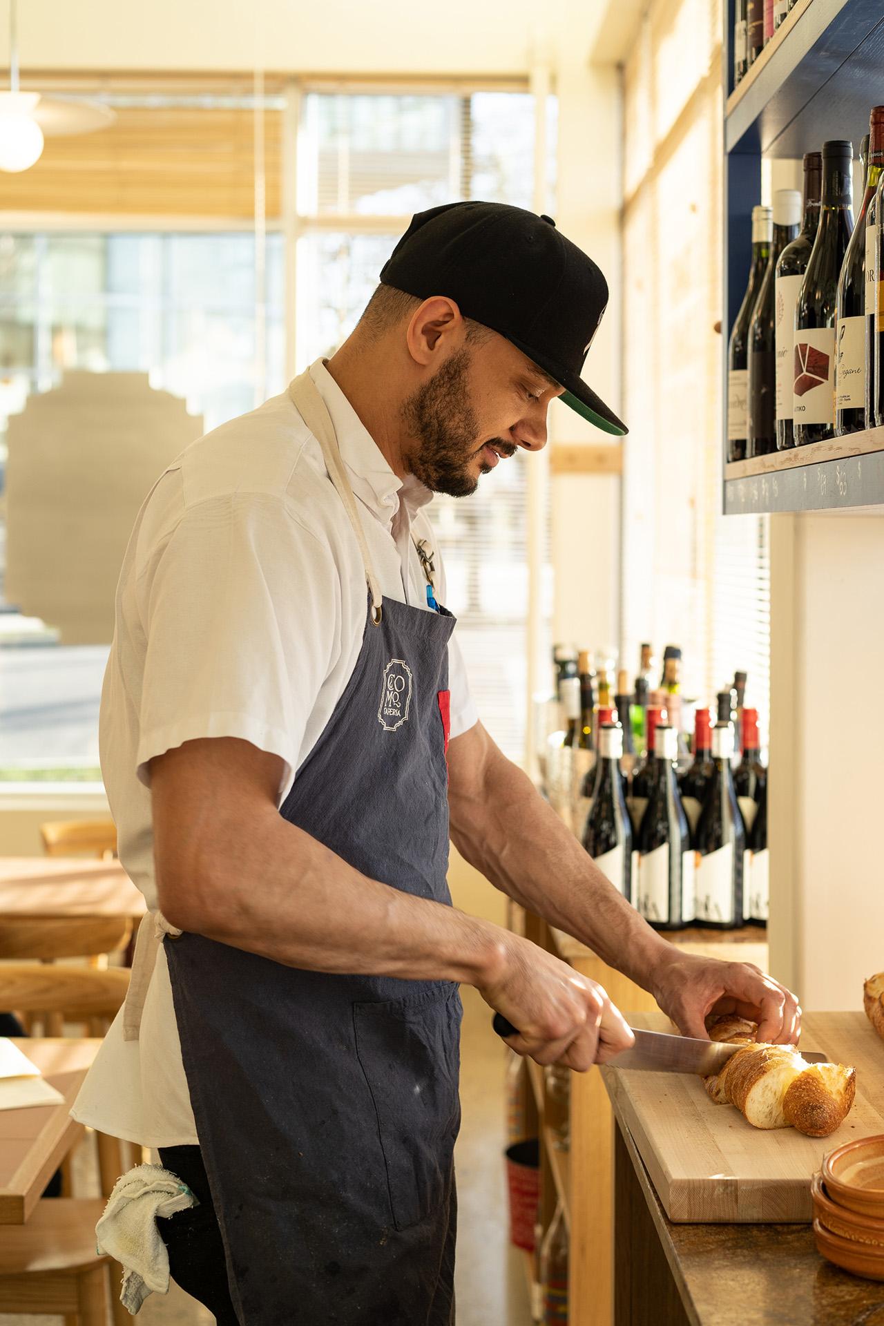 Preparing freshly baked bread for dinner service.