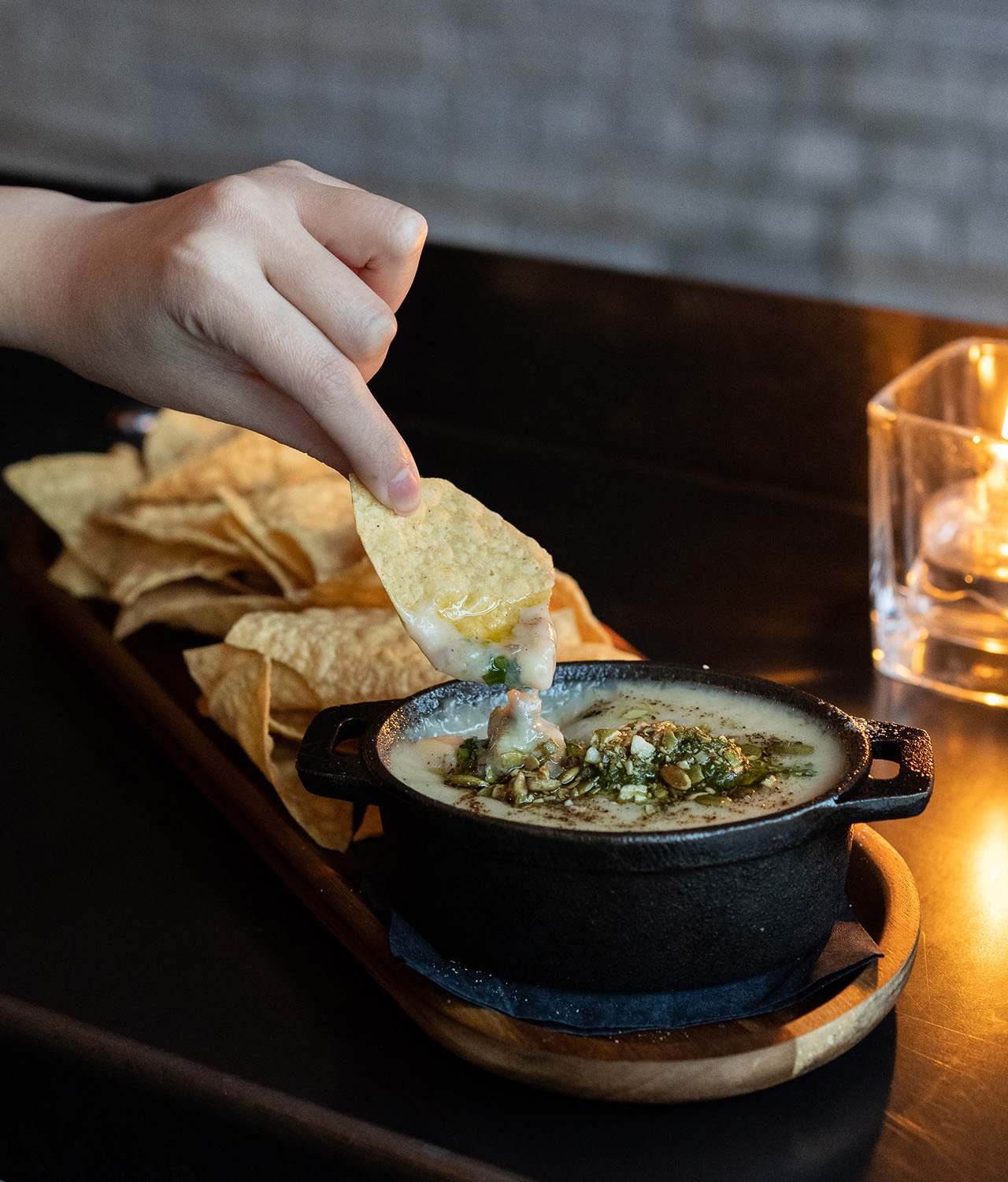 White Bean Queso Blanco Fundido with Corn Chips.