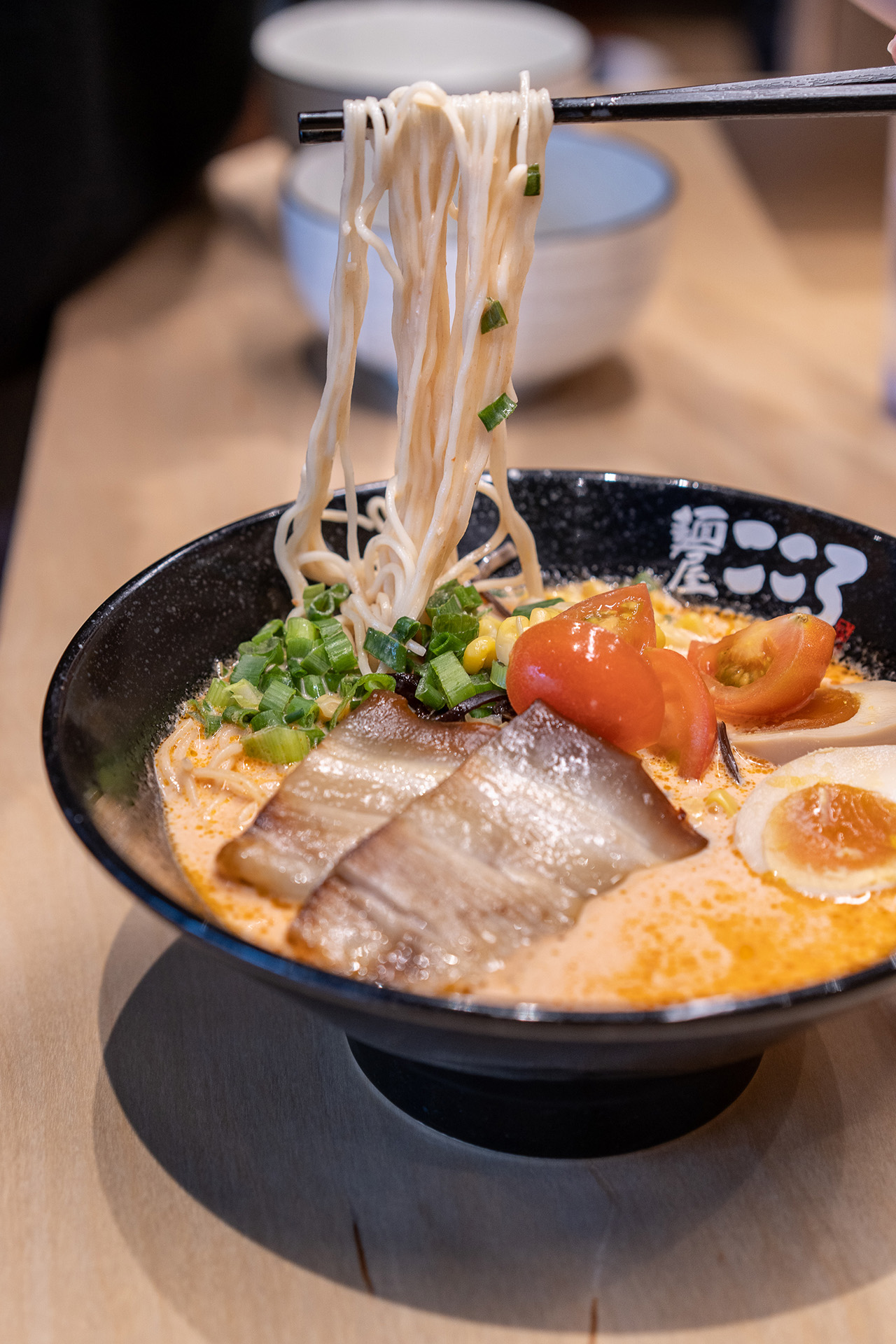 Mix all the ingredients for an authentic mazesoba experience.