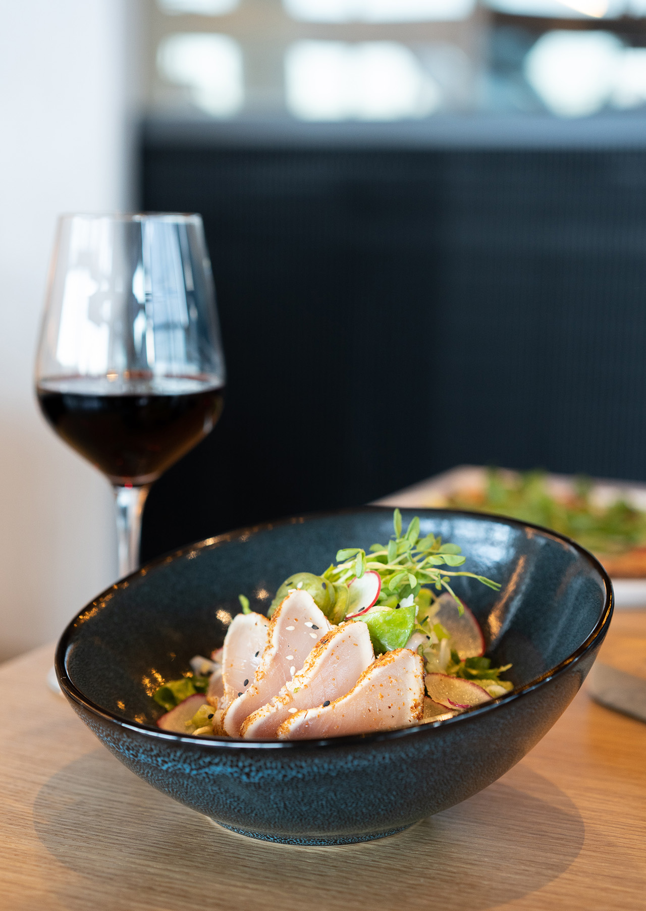 Maguro Tuna Salad with Albacore tuna tataki, rice noodles, vegetable julienne, mixed greens, miso ginger dressing