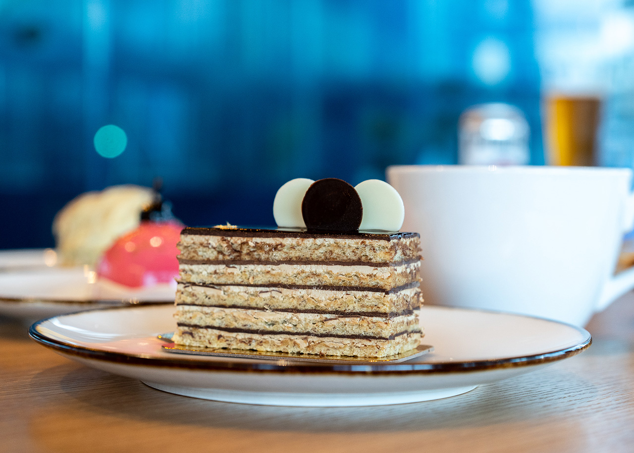 The Opera. Hazelnut sponge cake, espresso buttercream, chocolate ganache, gold leafOpera:Hazelnut sponge cake, espresso buttercream, chocolate ganache, gold leaf.