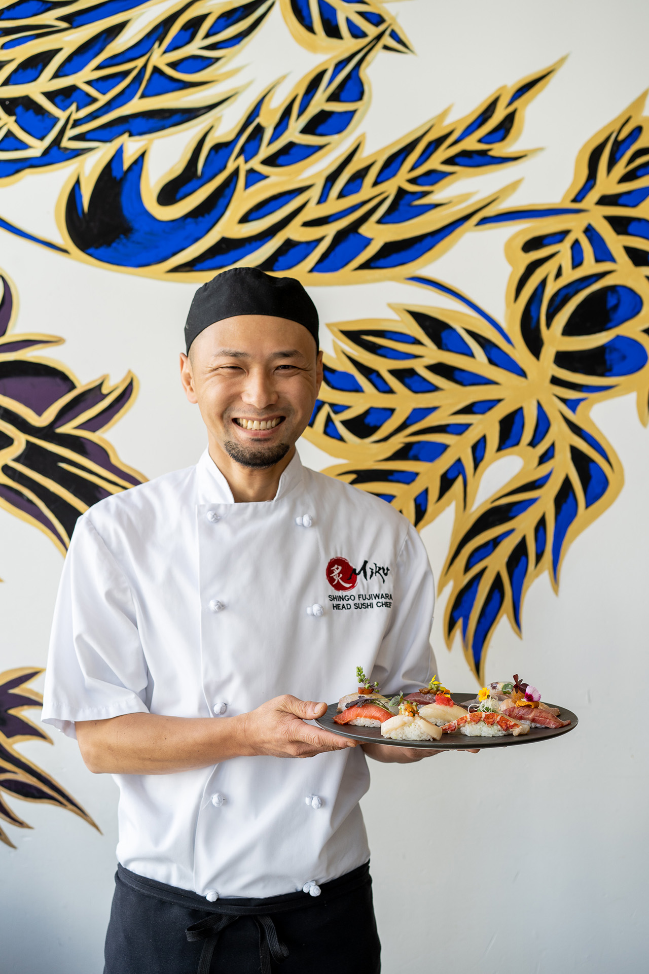 Head Sushi Chef Shingo Fujiwara proudly showcases his creations.