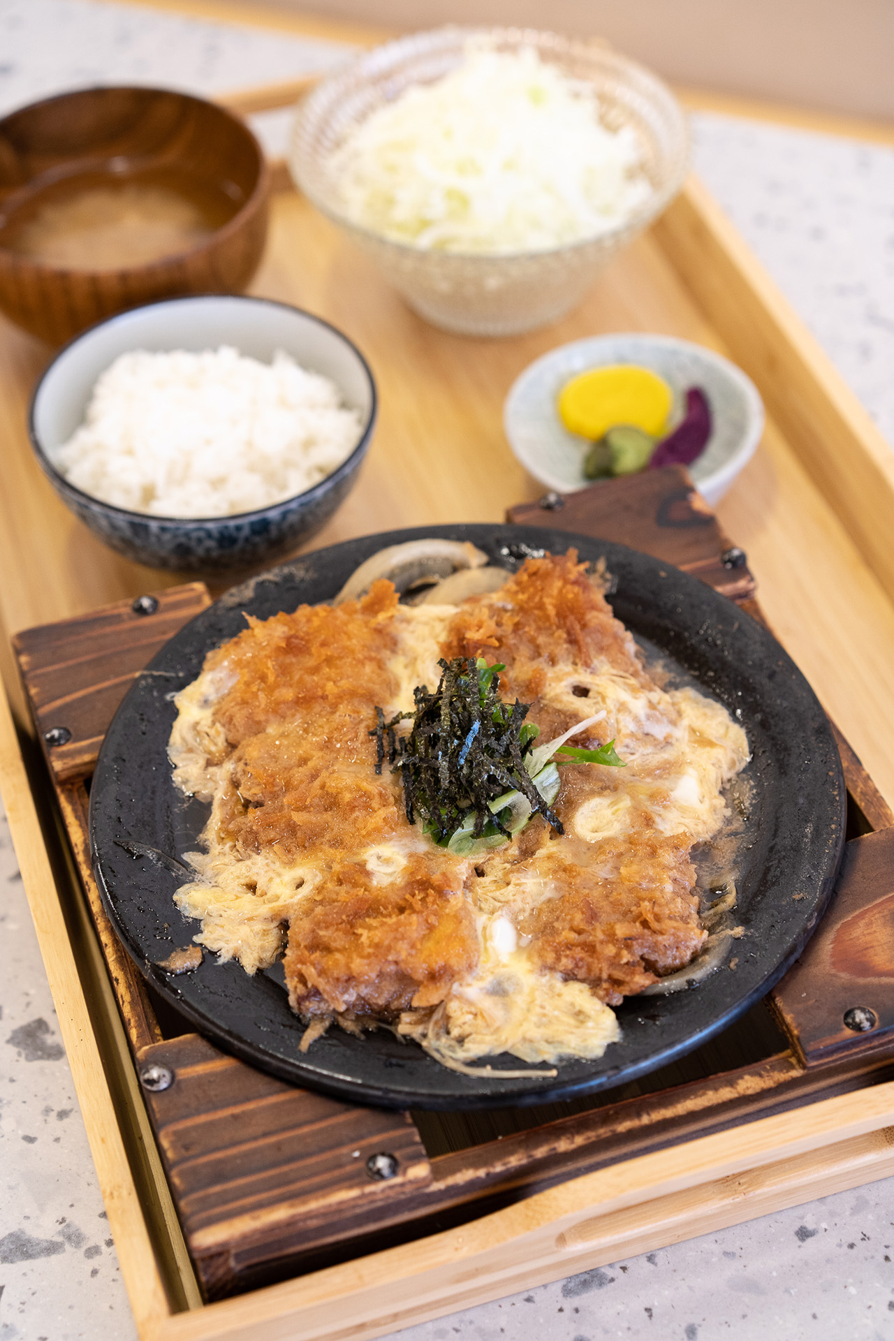 Katsu Nabe. Deep fried breaded pork loin mixed with egg, onion, and mushroom in housemade sauce.