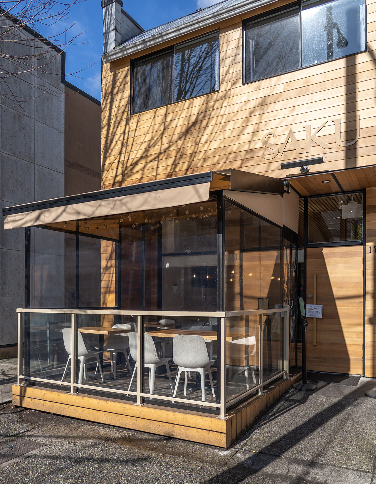 The contemporary wooden exterior with an enclosed patio.