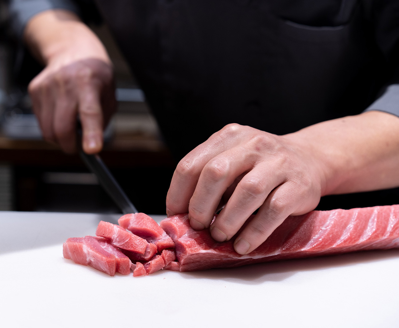 Chef Jin slicing toro sashimi.