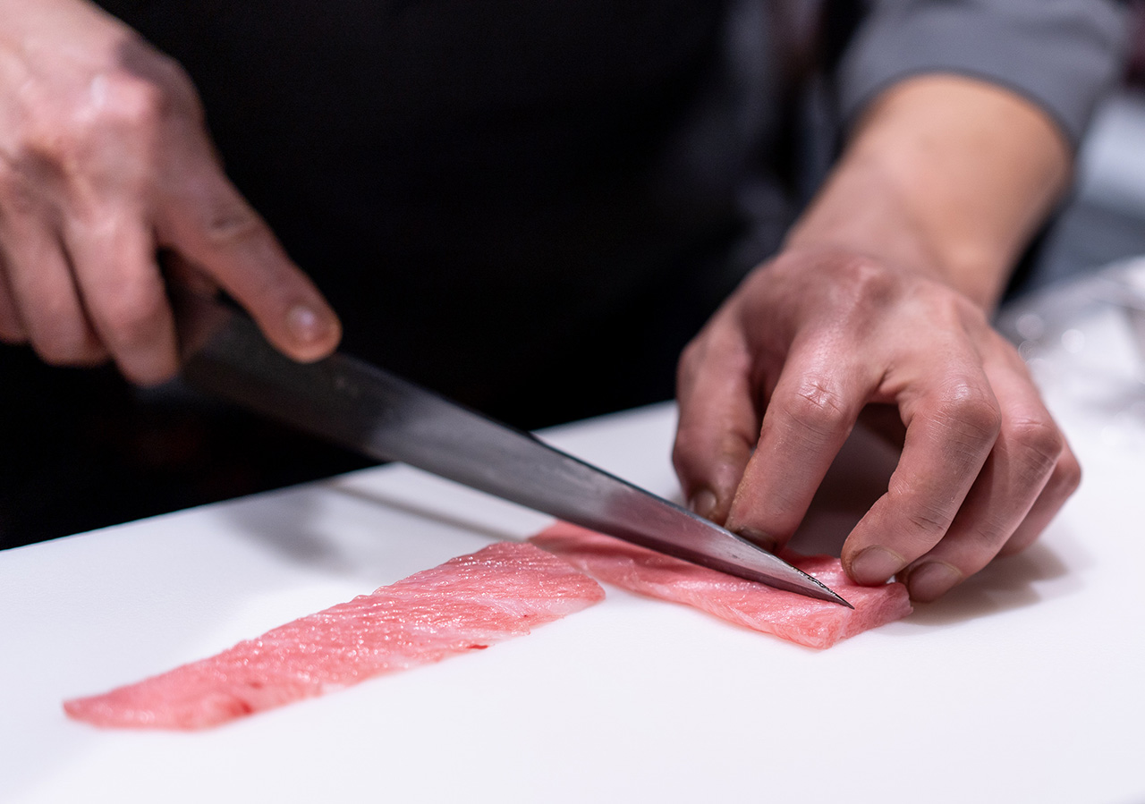 Slicing pieces of o-toro.