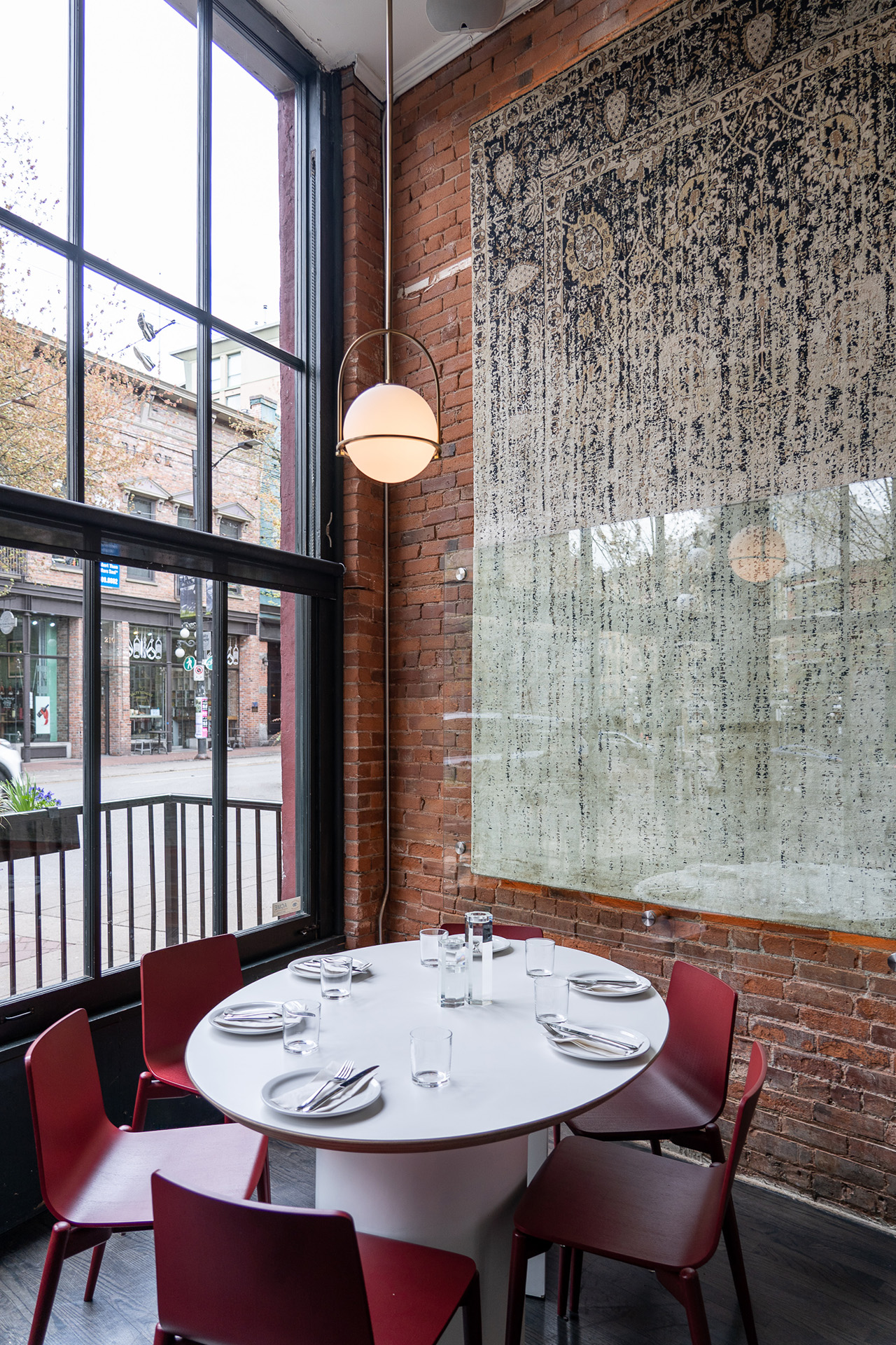 Statement rug anchors the restaurant's characteristic decor.