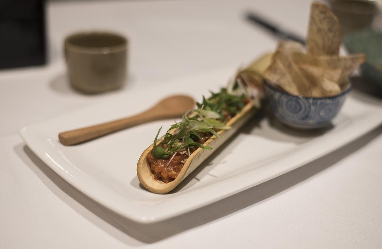 Sockeye Salmon Sanshozuke-ae - sockeye salmon tartare in a sanshozuke dressing (jalapeno, koji rice-malt, shoyu) topped with pine nuts & served with taro potato root chips.