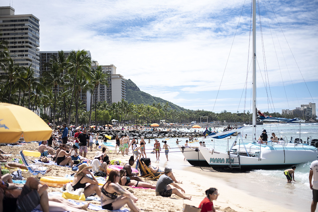 Prince Kuhio Beach Packed with visitors.