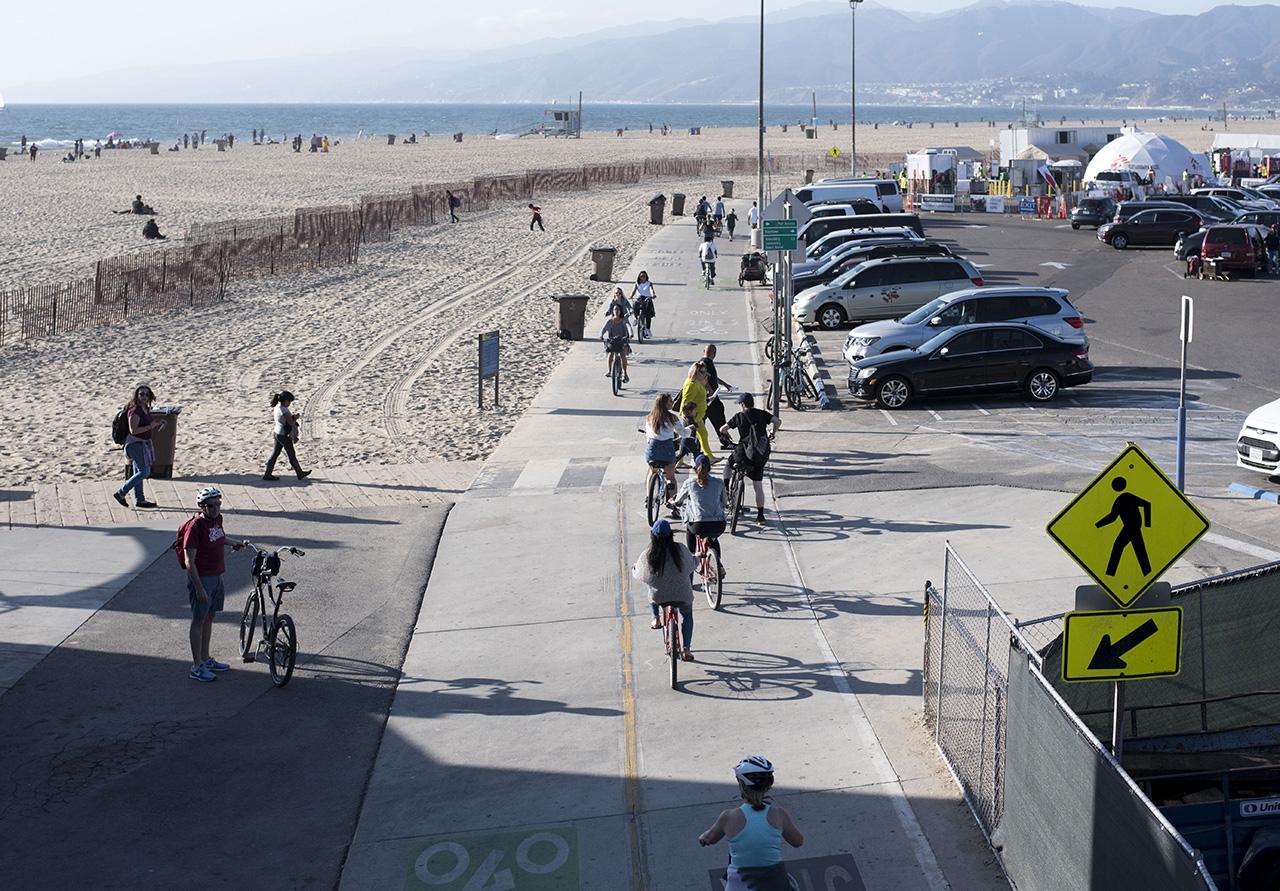 Bikers ride leisurely in the bike lanes.