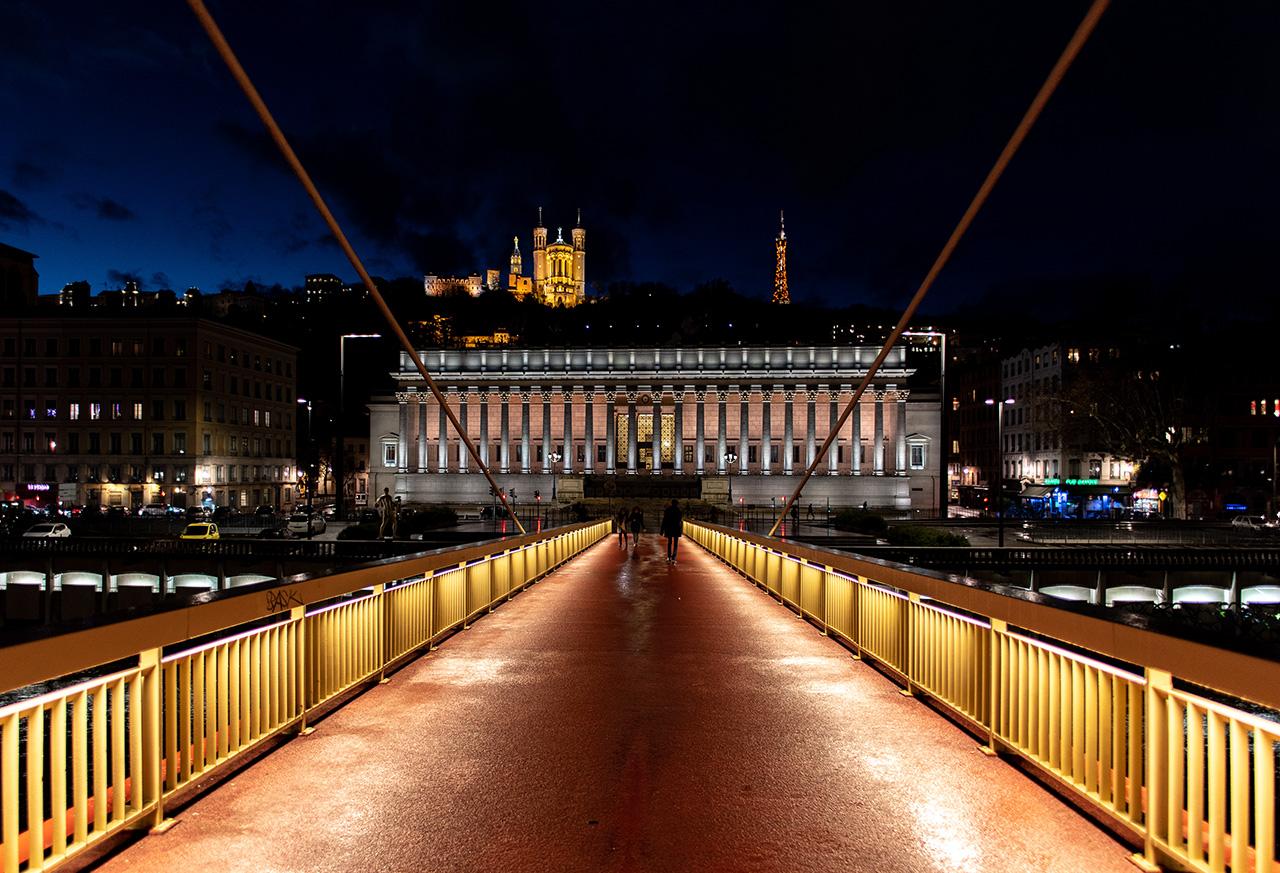Walking across the 413 feet pedestrian bridge spanning the width of the Saône River.