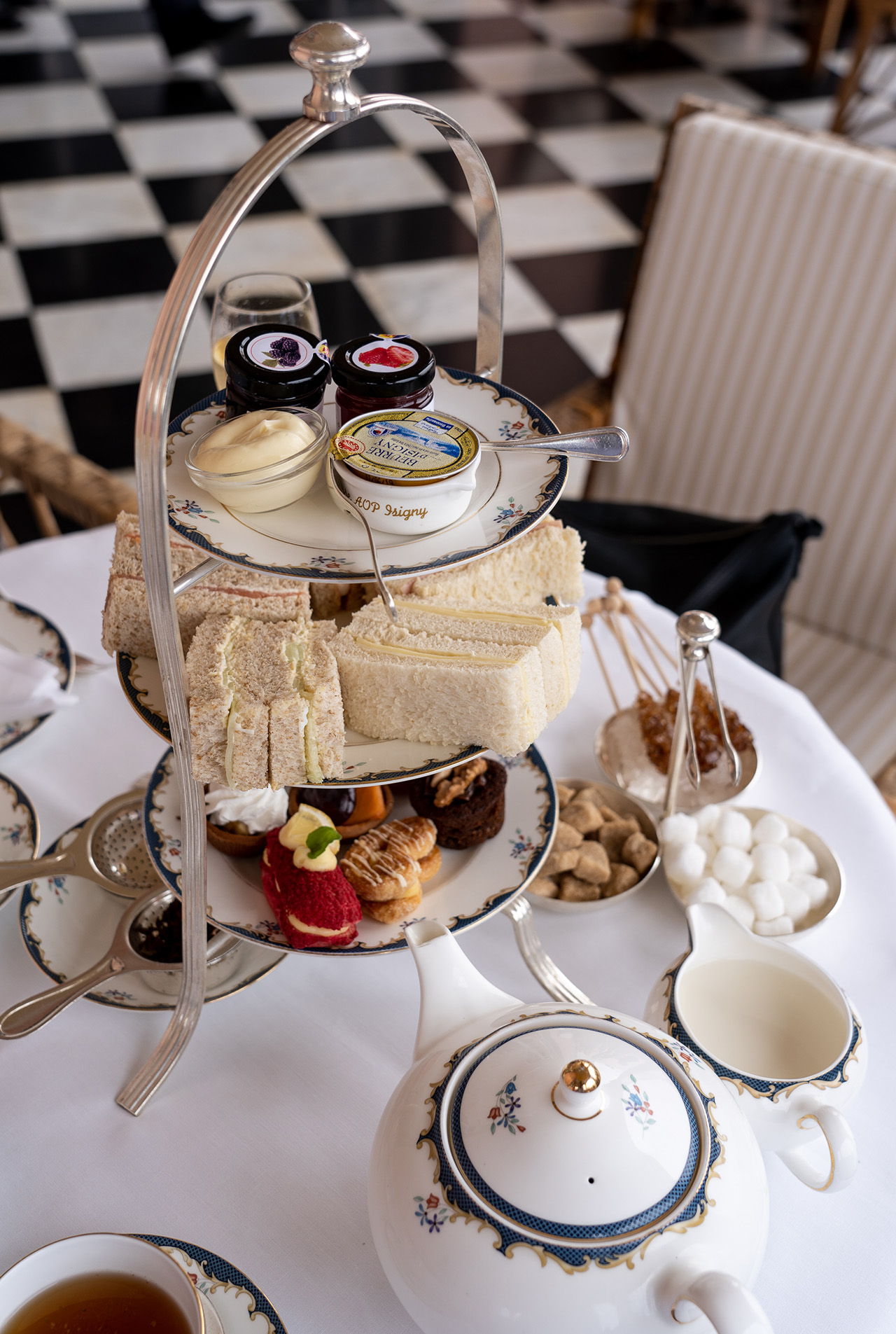 Triple tier presentation. Scones are served after you finish the sandwiches.