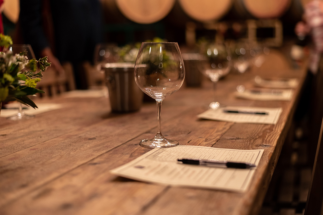 Wooden long table for wine-tasting.