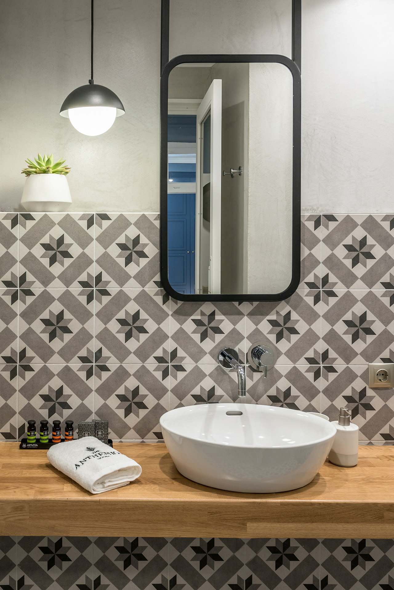 Geometric tiles in the bathroom gives the space added character.