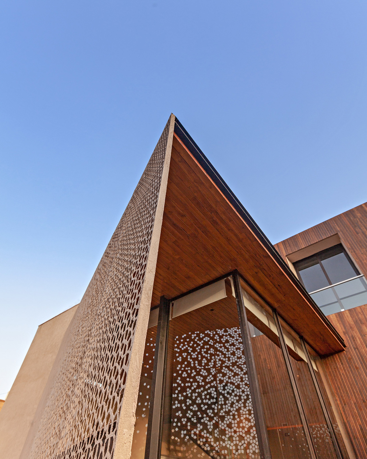 Custom filigree screen protects the structure from the blazing sun