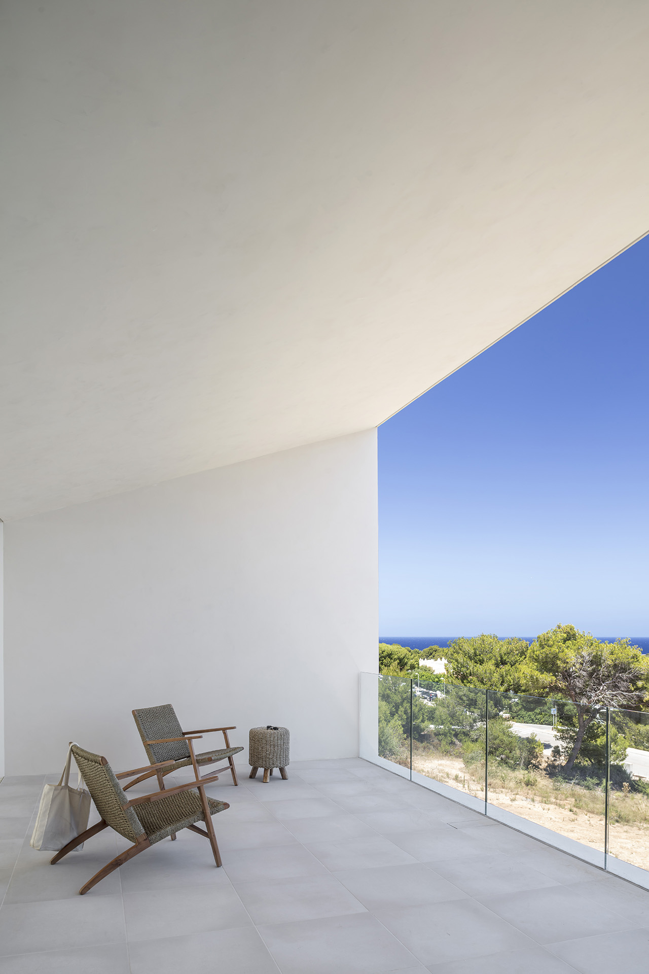 The inclined roof draws your eyes up towards the vast stretch of blue sky.