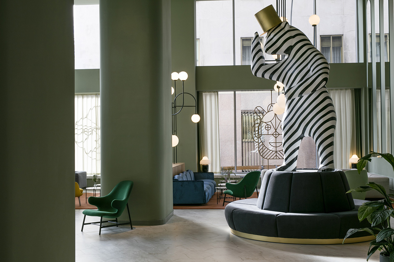 Lobby: Bear Sculpture, face sculpture and strcutural lights special design by Jaime Hayon for Hotel Barceló Torre de Madrid. Catch Lounge Chair by &tradition. Chinoz Lamps by Parachilna. Soft Beat Sofa by Arlfex.