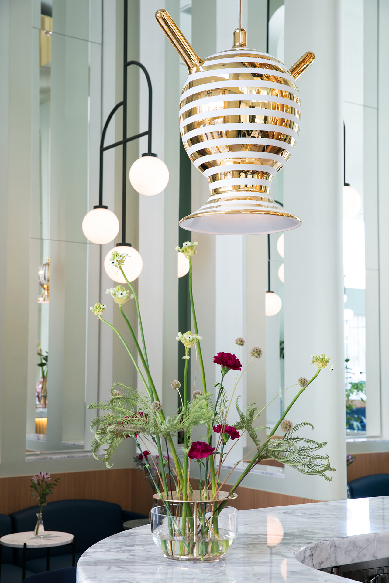 Garra Lobby Bar: Custom made ceramic lamps and structural lamps designed by Jaime Hayon specially for Hotel Barceló Torre de Madrid. Ikebana vase by Fritz Hansen.