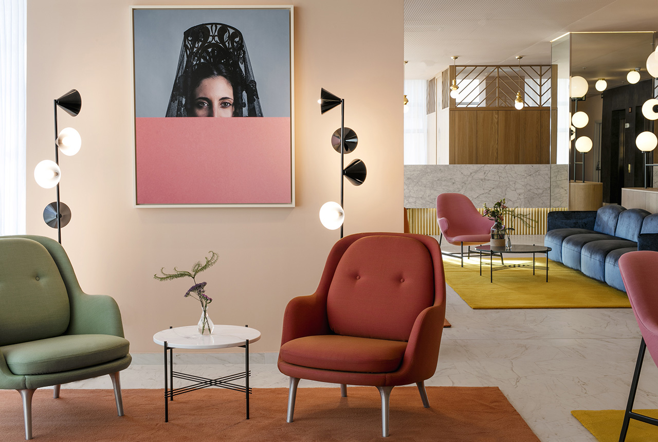 Reception Area: Portrait by KlunderBie for Hotel Barceló Torre de Madrid, Vertical 1 Floor Lamp by Areti, GamFratesi TS Table by Gubi, Fri Poltronas by Fritz Hansen. Catch Lounge Chair by &tradi- tion. Soft Beat Sofa by Arlfex.