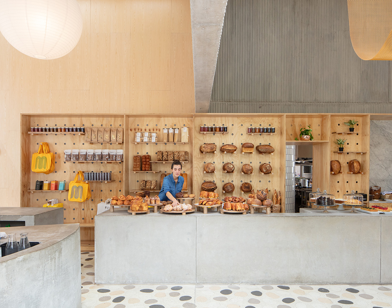 ©NahoKubota.  The organized bakery space filled with delicious baked goods.