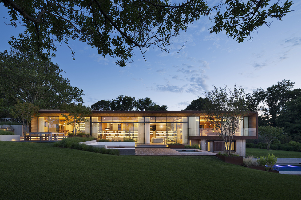 Mapos incorporates large floor-to-ceiling windows to bring nature in.