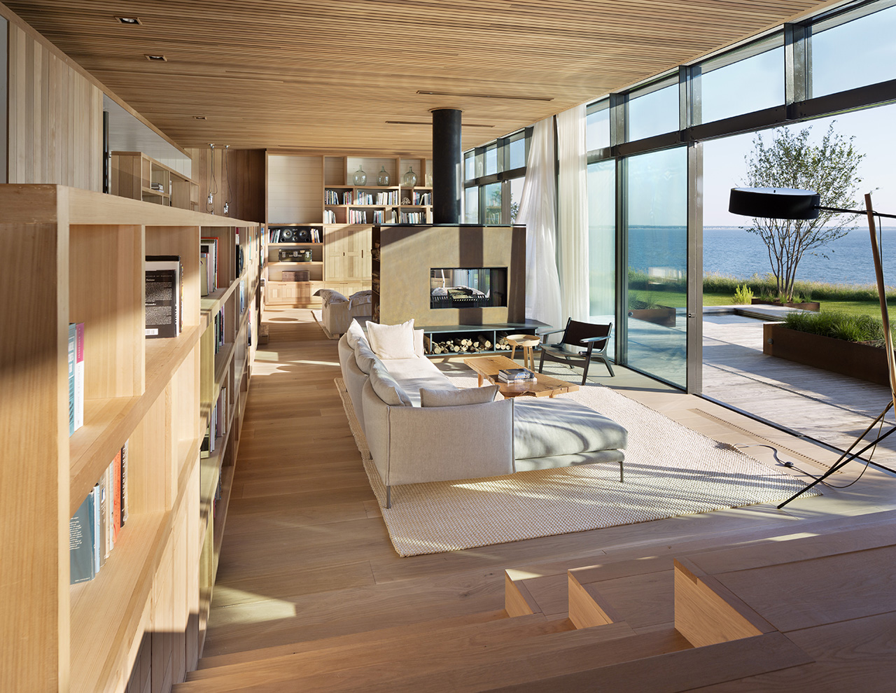 The family room overlooks the large yard and the picturesque Peconic Bay.
