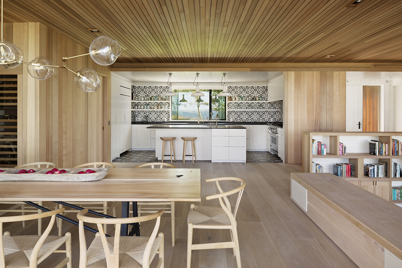 Colour blocking is used to segregate the kitchen space from the living and dining area.