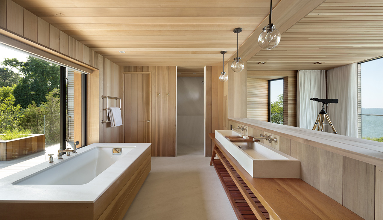 Open concept washroom with views of both the forest and the ocean on either side.