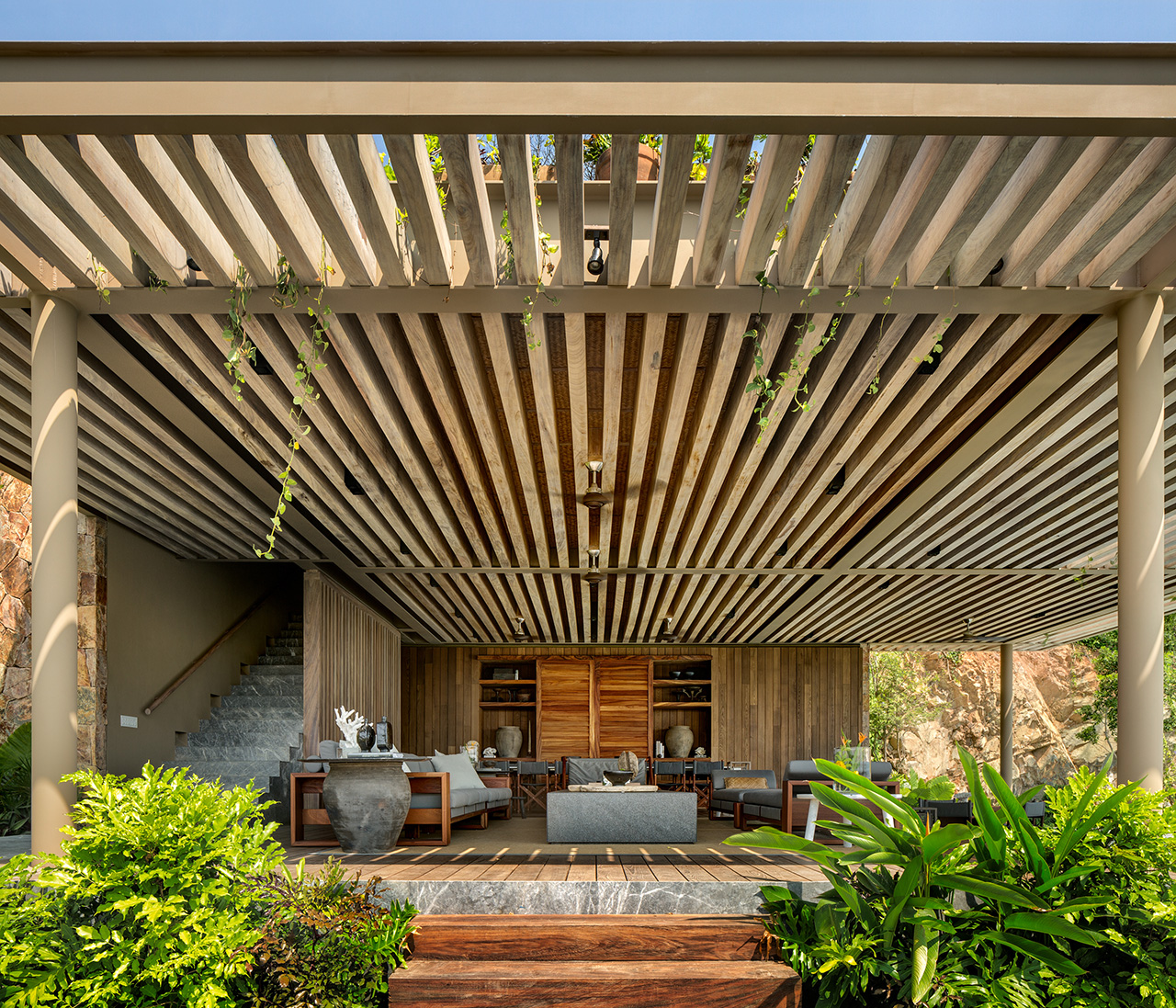 The structure considers the sun's heat and is designed to provide comfort with shaded gathering spaces.