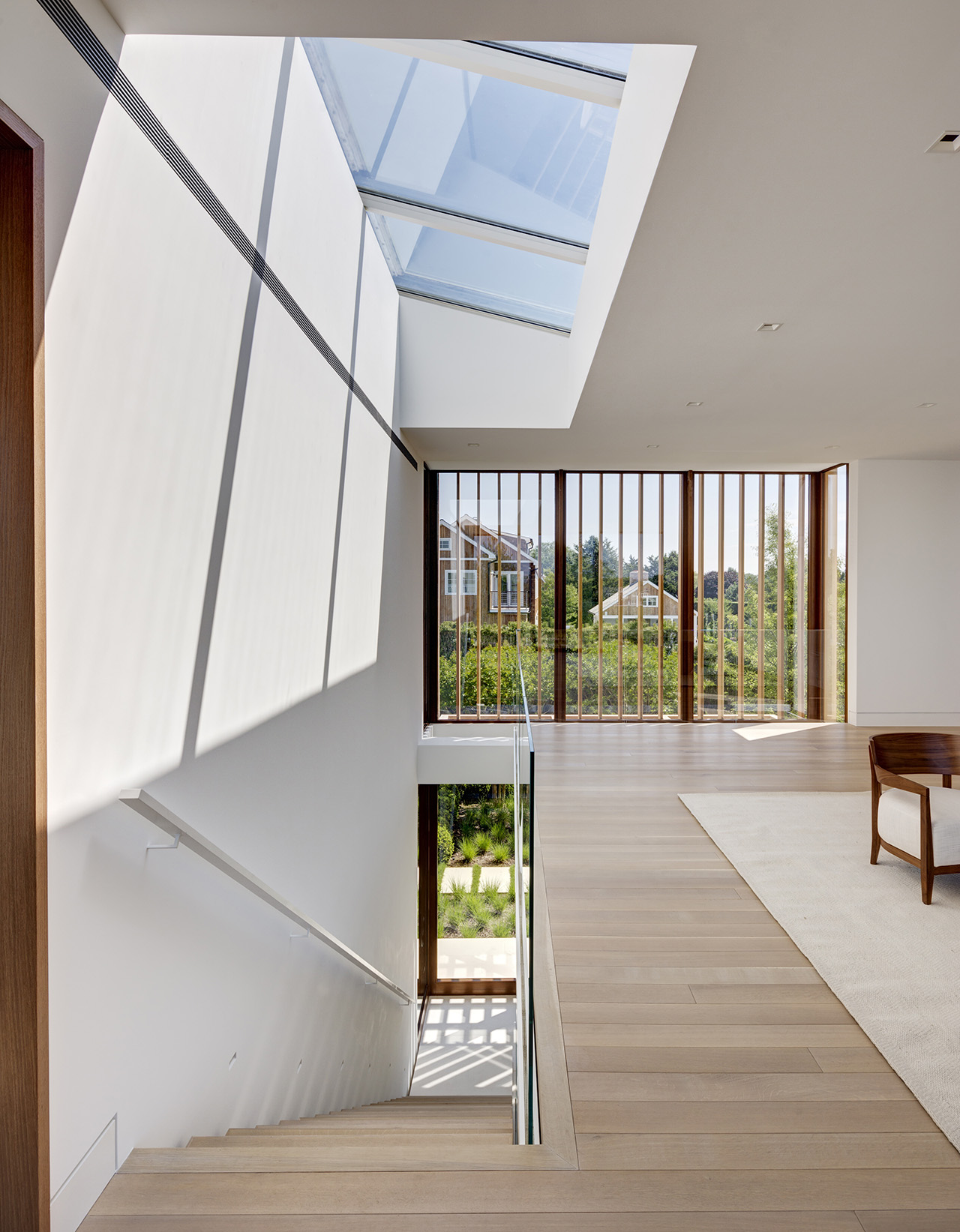 A large clearing on the upstairs landing serves as a comfortable gathering space.