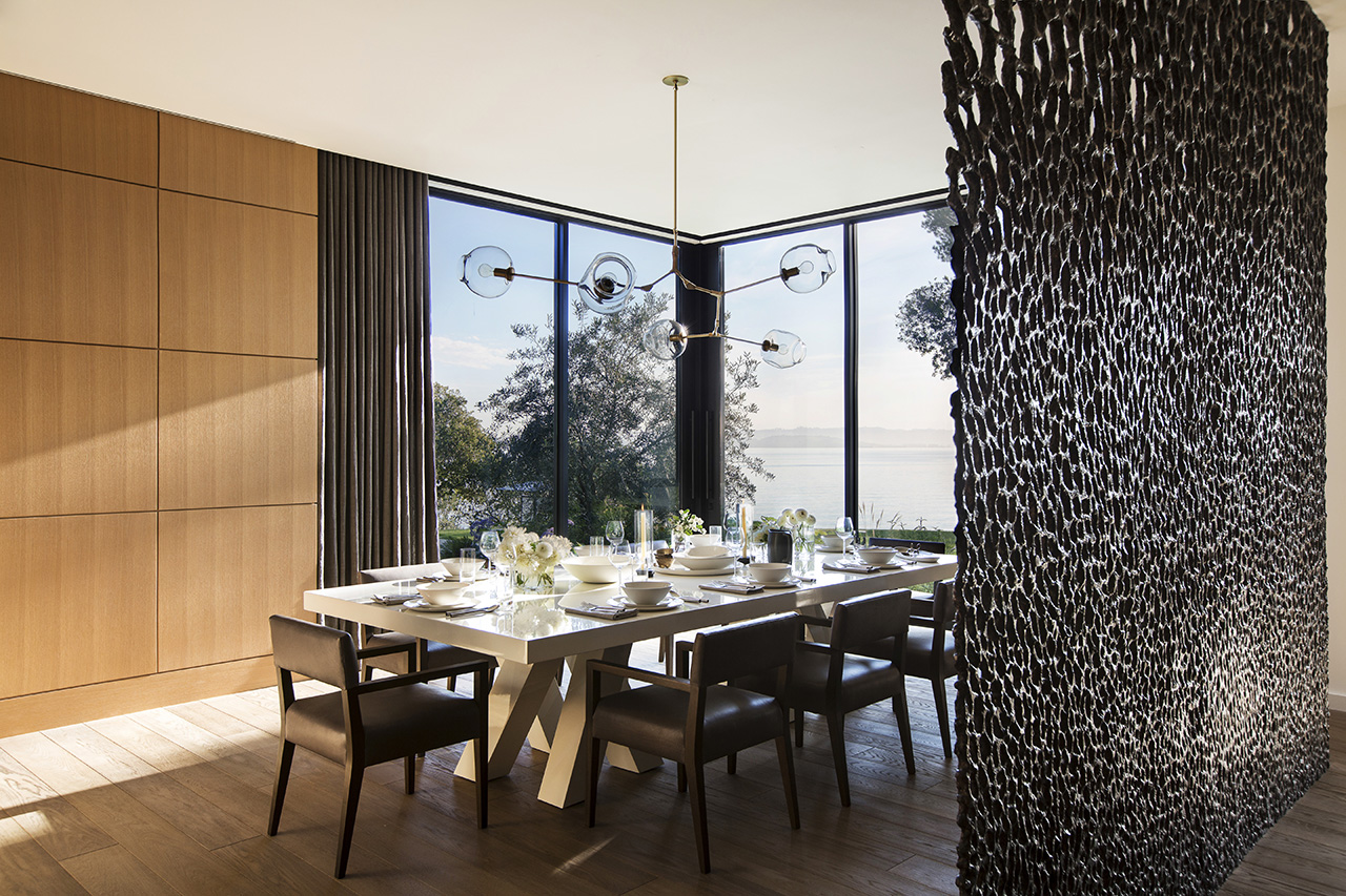Large sculpture acts as a separator between the living space and the stairway leading to the more private upper-floor.