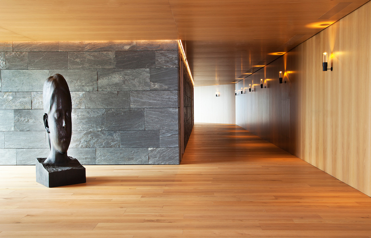Sleek common area corridors using natural materials for a minimal look.